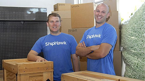 ShipHawk's Aaron Freeman, left, and CEO Jeremy Bodenhamer have started a company to help simplify the packing and shipping process the way Kayak simplifies travel shopping. (Stephen Nellis photo)