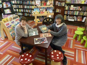 Ellen Burnham, children's book coordinator at Granada Books, and store owner Sharon Hoshida. The independent bookstore in downtown Santa Barbara is participating in a new holiday shopping initiative called Small Business Saturday. (Stephen Nellis / Business Times photo )