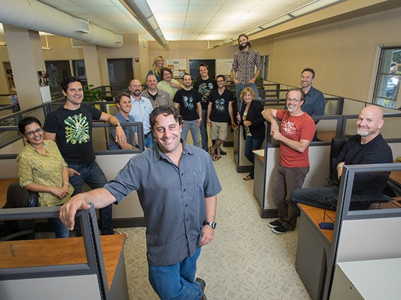Employees of Santa Barbara-based HG Data, including CEO Craig Harris, front. The company is moving from downtown to an industrial area of the city, citing lower costs. (Business Times file photo)