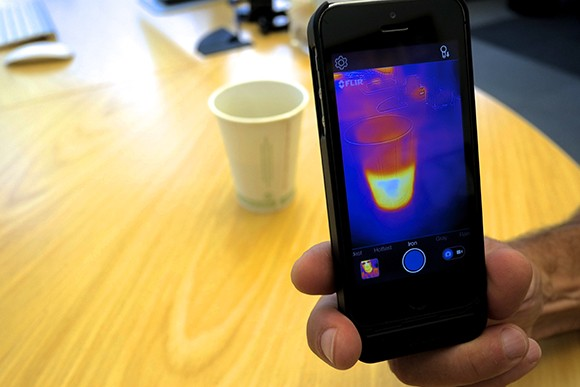 Flir General Manager Bill Terre shows the company's new infrared phone app recording a cup of coffee. (Stephen Nellis / Business Times photo)