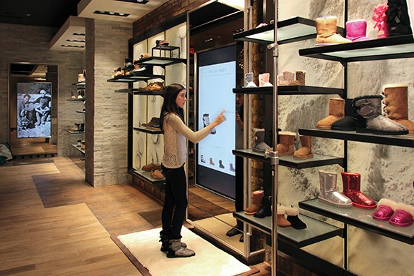 A shopper navigates Deckers Brands' so-called omni-channel retail concept at the company's newest Ugg Australia store, in Washington, D.C. (Courtesy image)