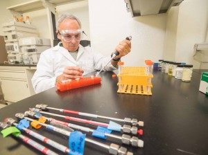 George Savic of Analytical Ventura prepares pipe samples in his incubator space at the Ventura BioCenter.
