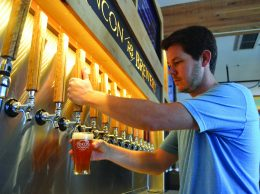 Shaun Crowley pours a beer at Rincon Brewery in downtown Carpinteria on April 25.